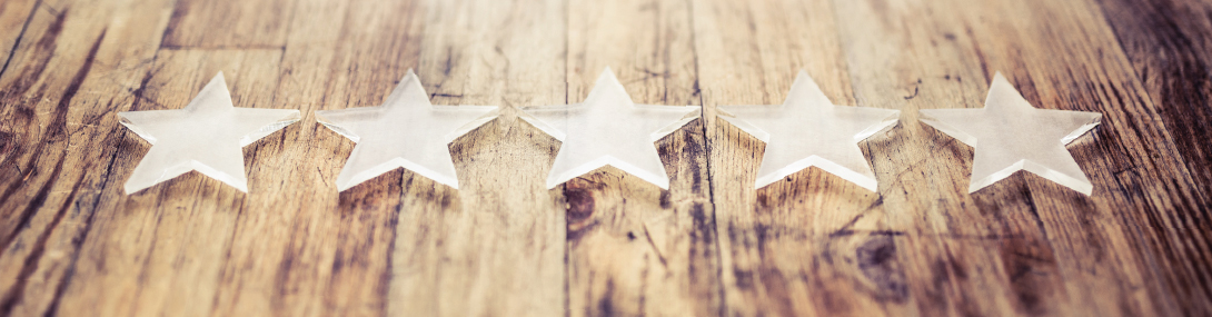 Five decorative stars on a wooden table.