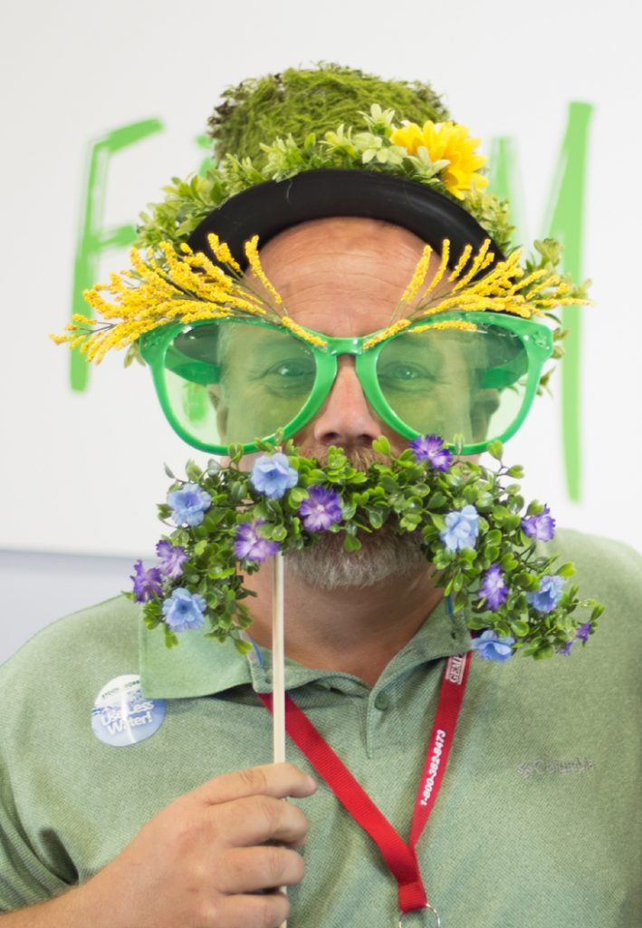Man with a eyebrows and mustache made out of plants.